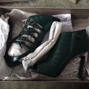 "BCBG green booties. Never worn. "" DRIVE "" size 6."